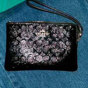 Coach wristlet with embossed leather